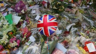 Flowers and a Union Flag balloon