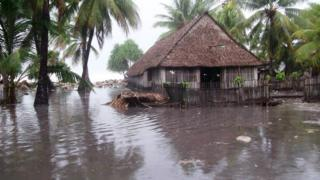 In this handout image provided by Plan International Australia, flood waters surround a house 13 March 2015 on the island of Kiribati