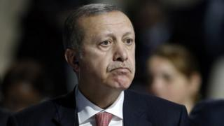Turkey's President Recep Tayyip Erdogan listens to statements at the COP21, United Nations Climate Change Conference, in Le Bourget, outside Paris, on Monday