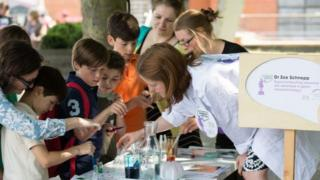 A scientist gives children a Soapbox Science demonstration
