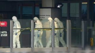 Forensic teams working at the site in Manchester