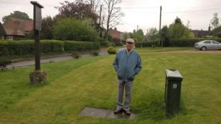 Raymond Moreton stands by the junction box in his garden