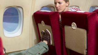 Пасажири в літаку