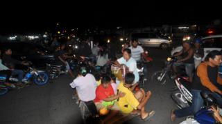 Indonesian residents use a variety of transport options as they rush to higher ground in Padang