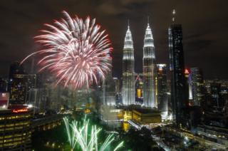 Fireworks illuminate the night sky over Malaysia's Petronas Towers during New Year's Eve celebrations in Kuala Lumpur, Malaysia, 01 January 2018.