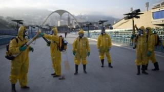 Health workers get ready to spray insecticide to combat mosquitoes that transmits the Zika virus in Rio de Janeiro, 26 January