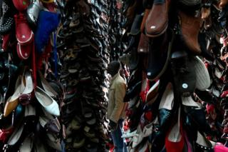 A customer looks at shoes made in China on display at a store in the central business district of Nairobi on January 10, 2018.