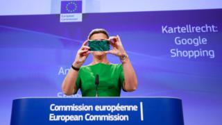 European Commissioner for Competition Margrethe Vestager with her mobile phone during a press conference