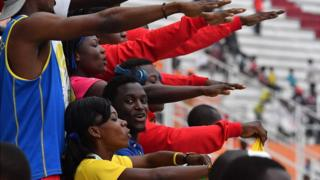 """Congo's supporters sing their national anthem at the Felix Houphouet-Boigny in Abidjan during the eighth """"Jeux de la Francophonie"""" (French Speaking) Games on July 24, 2017 in Ivory Coast."""
