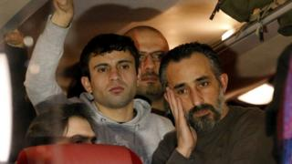 Refugees inside a bus which travelled from the Bavarian town of Landshut to the Chancellery building in Berlin, Germany, January 14, 2016.