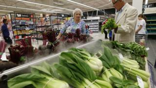Customers shopping for vegetables