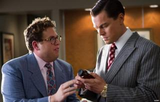 Leonardo DiCaprio holding Quaaludes in Wolf of Wall Street