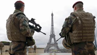 French army paratroopers patrol near the Eiffel Tower in Paris, in this picture taken on 30 March 2016.