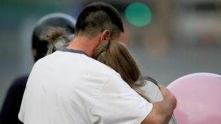 Man comforting a teenager after the Manchester Arena attack