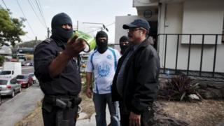 Police investigators stand outside the Mossack Fonseca offices in San Salvador, El Salvador April 8, 2016