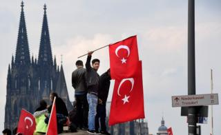 Supporters of Turkish President Recep Tayyip Erdogan rally at a gathering on July 31, 2016 in Cologne, Germany