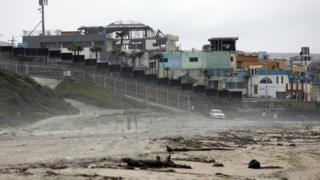 US border patrol watch the 'Friendship Fence' which is already in place near the US city of San Diego