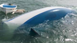 A photo of the capsized boat taken from a GoFundMe page set up by the couple.