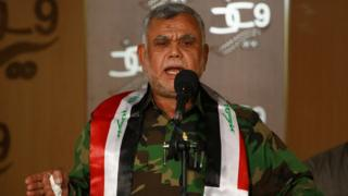 Hadi al-Ameri, who is in charge of the Shia Muslim Badr Brigades, delivers a speech on Russia's military intervention in Syria and on the ongoing conflicts in Iraq and Yemen, on October 5, 2015, in the southern Iraqi city of Naja