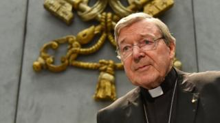 Australian Cardinal George Pell looks on as he makes a statement at the Holy See Press Office, Vatican city