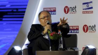 Former settler leader, Dayan, who was announced as the consul-general in New York on Monday, speaks at a conference on fighting the anti-Israel boycott, in Jerusalem on 28 March