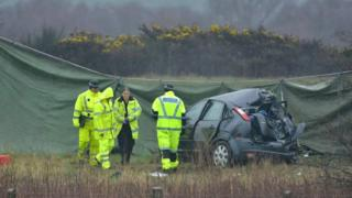 Police with crashed car