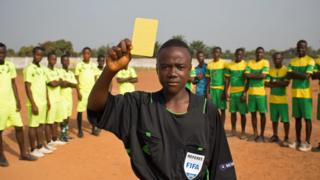 Isaac holds up his yellow card