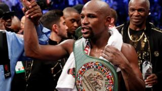 Floyd Mayweather Jr. celebrates with the belt after winning the fight against Conor McGregor (not shown) in Las Vegas, Nevada, U.S. on 26 August 2017.