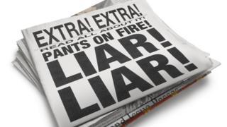 Newspaper with 'Liar Liar' headline