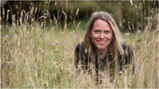 Amy Dickman in long grass