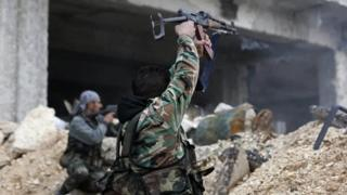 Syrian government soldiers fire their weapons in eastern Aleppo, Syria. Photo: 5 December 2016
