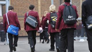 Boys walking into school