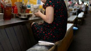 A woman eating alone in Seoul