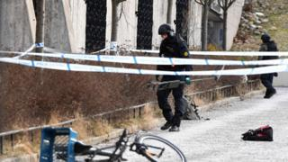 The police has cordoned off and investigates the area outside Varby Gard metro station south of Stockholm where two people were injured in an explosion on January 7, 2018.