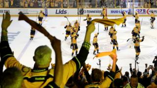 Fans cheer as the Nashville Predators celebrate after defeating the Pittsburgh Penguins with a score of 4 to 1 in Game Four of the 2017 NHL Stanley Cup Final at the Bridgestone Arena on June 5, 2017 in Nashville, Tennessee.