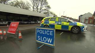 Police car at cordon in Woodborough Road