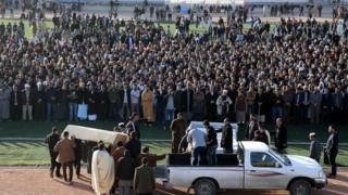 Mourners carry the coffins of people killed in a truck bombing in the north-western coastal city of Zliten