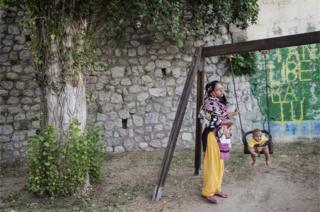 A woman from Bangladesh and her child in Riace