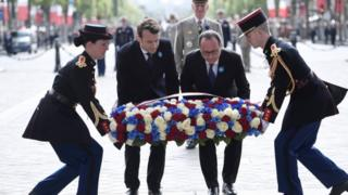 Mr Macron (centre left) on his first duty as president-elect, with President François Hollande (centre right), laying a wreath in Paris