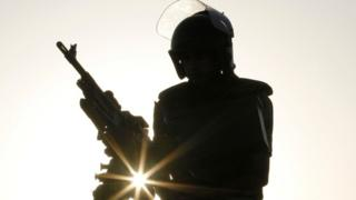 Armed Egyptian soldier in silhouette, 2011
