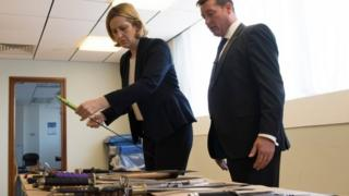 Home Secretary Amber Rudd being shown a collection of knives by Superintendent Sean Yates that have been involved in knife crime and recovered by the police in London