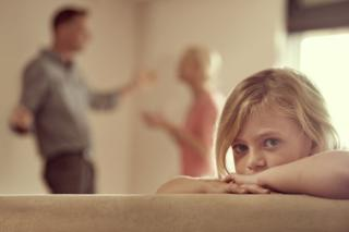 A little girl with arguing parents