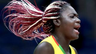 At the Olympics in Rio, Cameroon's Bodo Essissima Madeleine Samantha celebrates during a women's preliminary volleyball match.