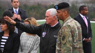 US Vice President Mike Pence (C) talks with US General Vincent K. Brooks (R), commander of the United Nations Command, Combined Forces Command and United States Forces Korea, as they visit Observation Post Ouellette near the truce village of Panmunjom in the Demilitarized Zone (DMZ) on the border between North and South Korea on 17 April 2017.