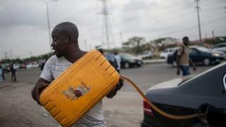 Filling car with fuel in Lagos, Nigeria. 10 April 2016