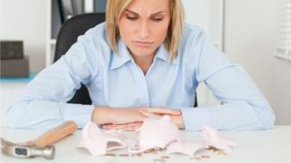 Woman with smashed piggy bank