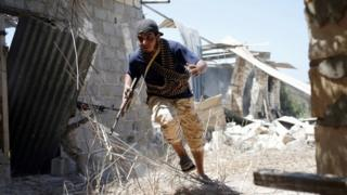 Libyan fighter allied to government during battle with IS in Sirte, July 2016