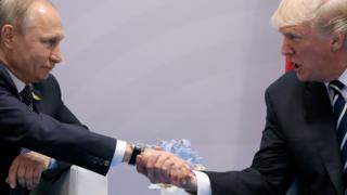U.S. President Donald Trump shakes hands with Russian President Vladimir Putin during the their bilateral meeting at the G20 summit in Hamburg, Germany July 7, 2017