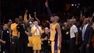 Los Angeles Lakers forward Kobe Bryant (24) waves to the Staples Center crowd as he leaves the game against the Utah Jazz in the closing seconds