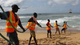 Fibre optic cable being pulled from the sea